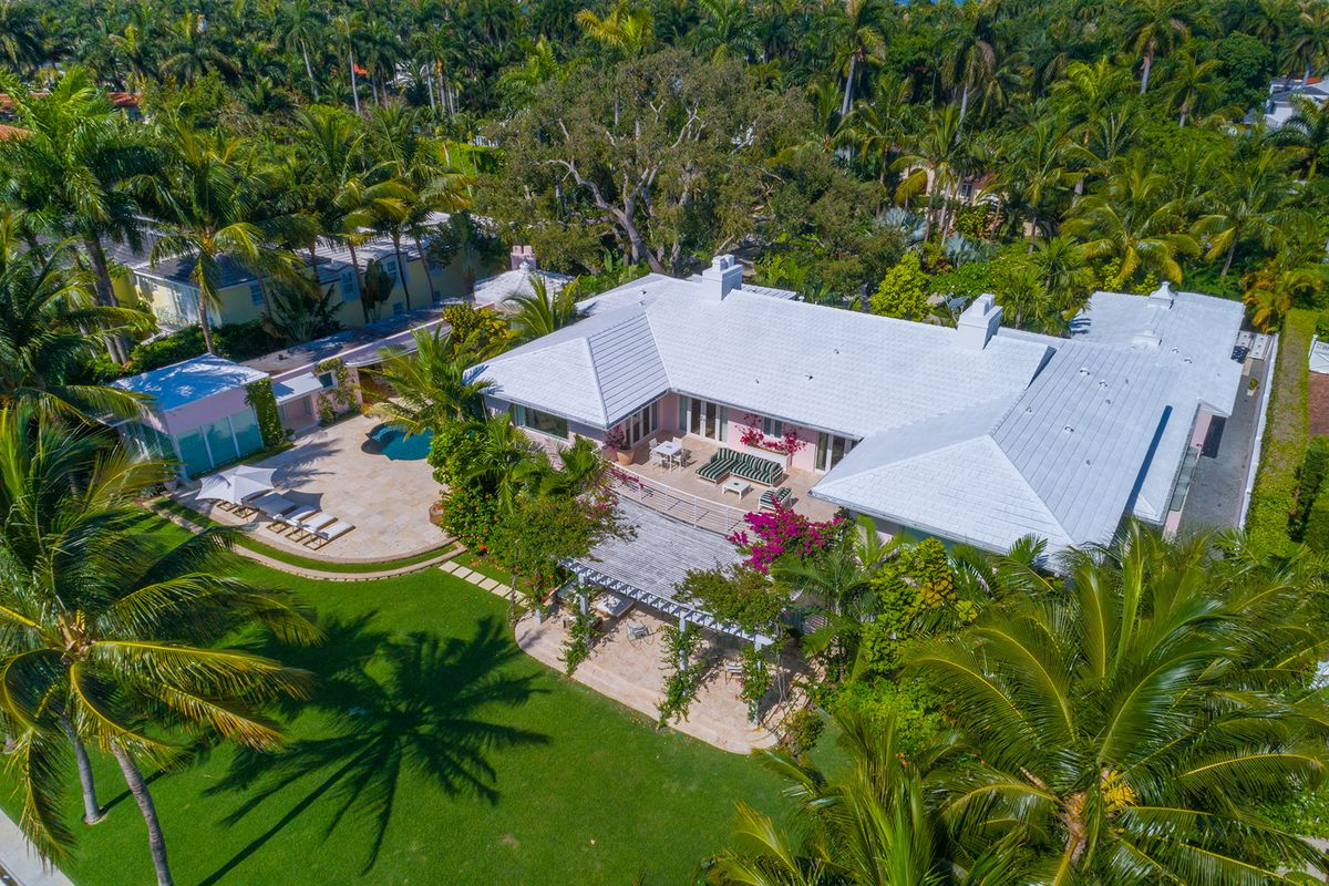 An aerial of 2555 Lake Avenue in Miami Beach with a white roof, pool and lush ground