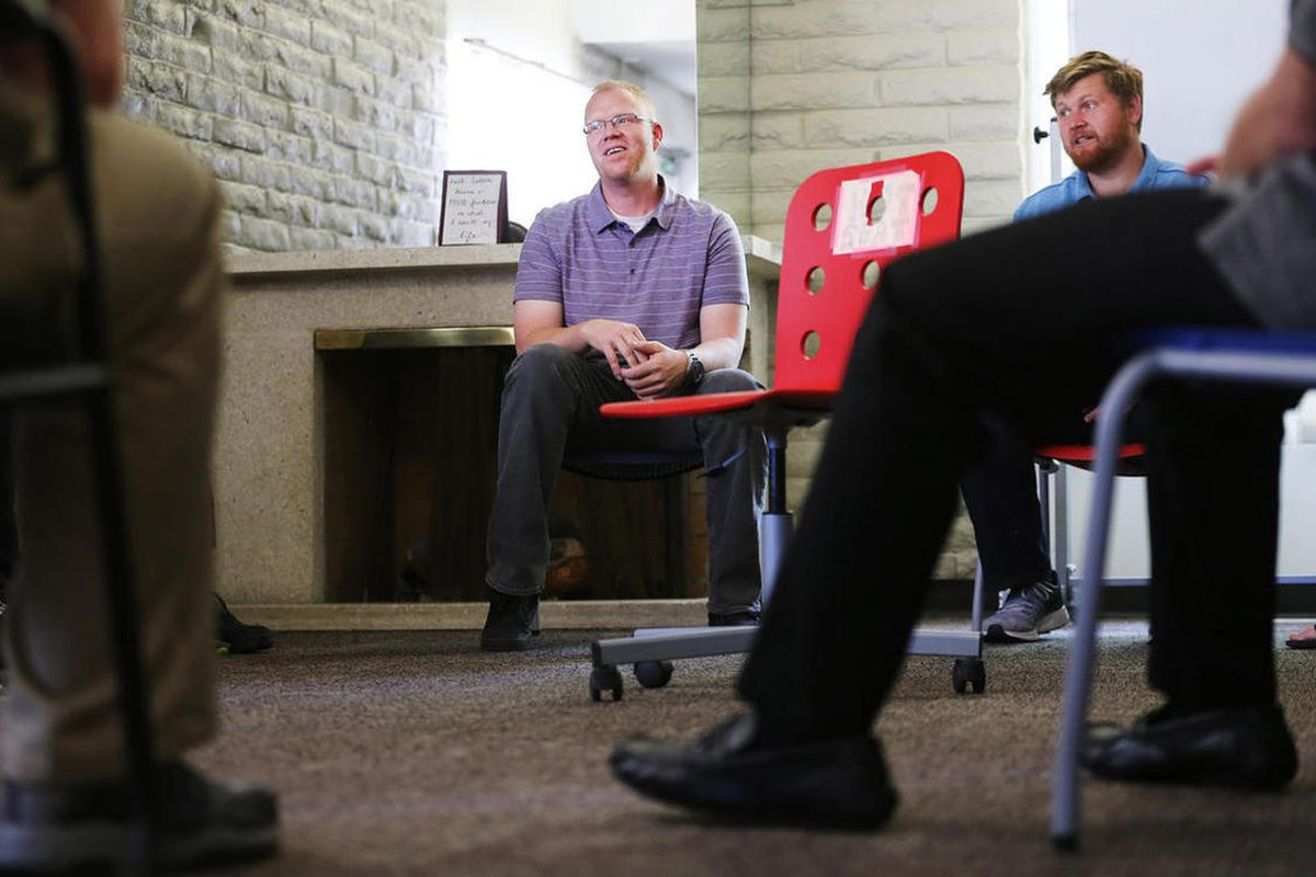 """Bradley Hieb, program director of the dual diagnosis program at New Roads Behavioral Health, and staff member Nick Bolton sit in on what they refer to as a """"hot seat"""" group meeting in Cottonwood Heights on Tuesday, June 6, 2017."""