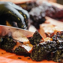 Dallman carefully blends the perfect ratio of meat, fat, and smoky bark.