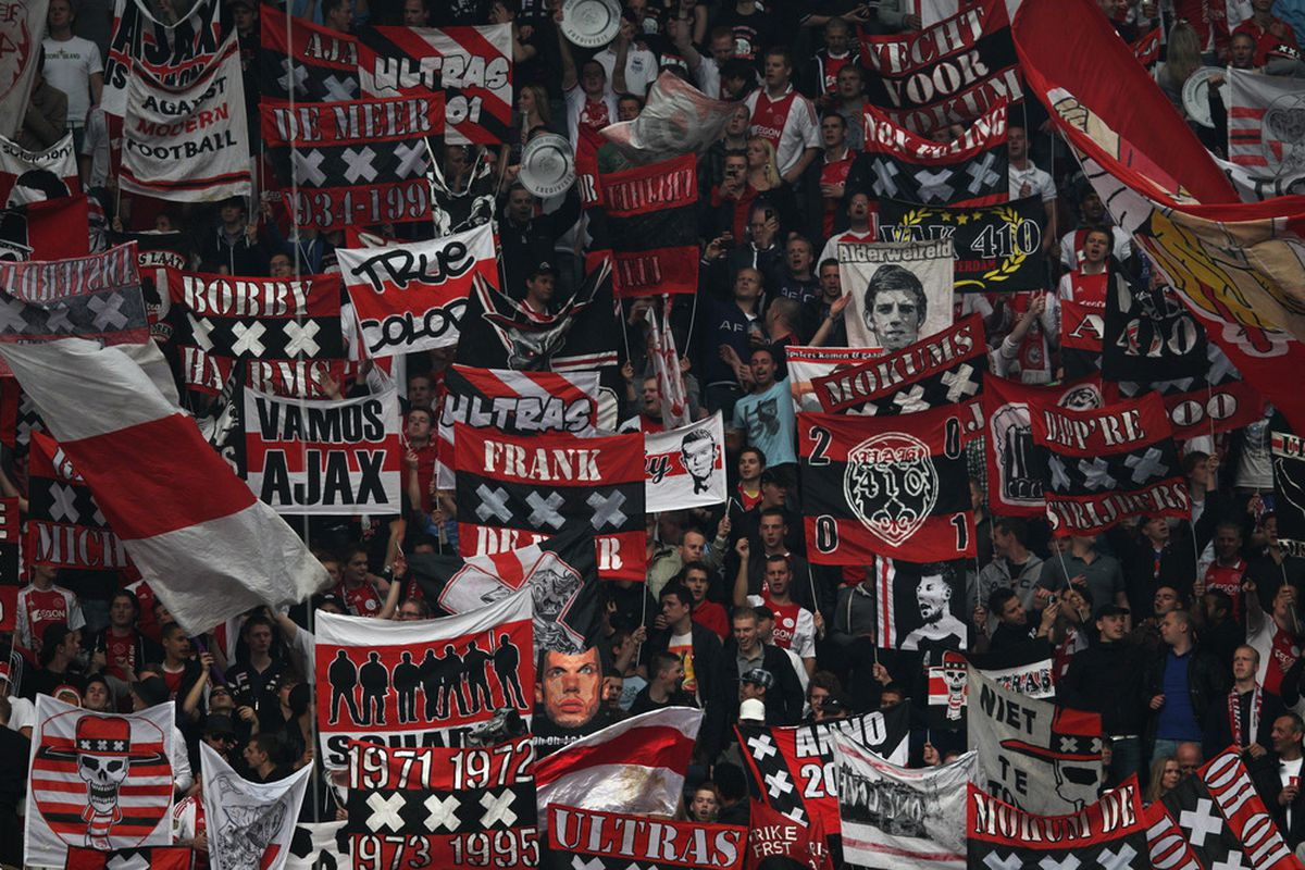 AMSTERDAM, NETHERLANDS - MAY 02:  Ajax fans cheer and wave flags during the Eredivisie match between Ajax Amsterdam and VVV Venlo at Amsterdam Arena on May 2, 2012 in Amsterdam, Netherlands.  (Photo by Dean Mouhtaropoulos/Getty Images)