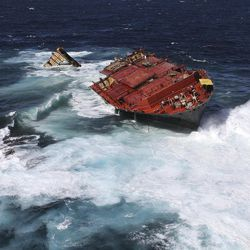 This Wednesday, April 4, 2012 photo supplied by Maritime New Zealand shows the broken hull of the Rena in heavy sea swells on Astrolabe reef near Tauranga, New Zealand. Maritime New Zealand on Thursday charged the owners of the Rena, Daina Shipping with discharging harmful substances from the vessel. The charge carries a maximum fine of 600,000 New Zealand dollars ($489,000) plus another 10,000 New Zealand dollars ($8,100) for each day the offending continues.