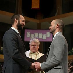 Matt Barraza and Tony Milner get married at the United Church of Christ in Holladay on Friday, Dec. 20, 2013. The Rev. Tom Norberg officiates. Barraza and Milner have been together for 11 years and have been raising their son Jesse since the day he was born four years ago.