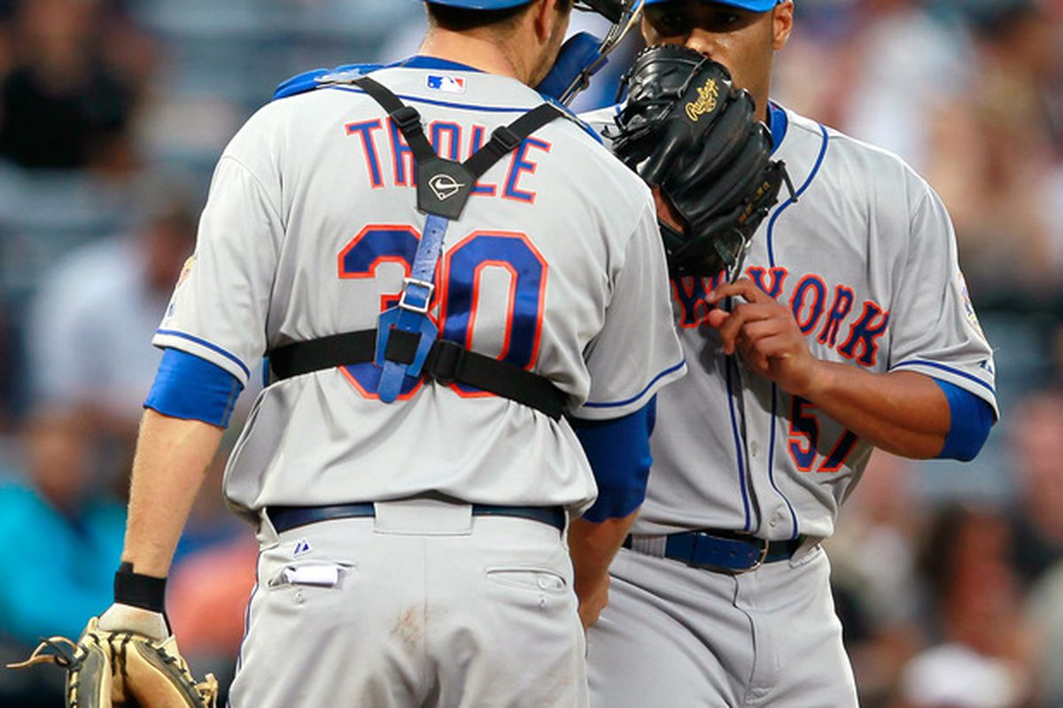 ATLANTA, GA - APRIL 17:  Josh Thole #30 of the New York Mets converses with Johan Santana #57 during the second inning against the Atlanta Braves at Turner Field on April 17, 2012 in Atlanta, Georgia.  (Photo by Kevin C. Cox/Getty Images)