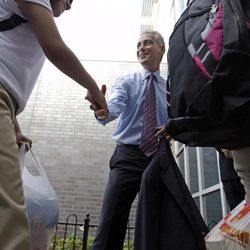 Chicago Mayor Rahm Emanuel greets students as they enter Shields Middle School on their first day back to school, Tuesday, Sept. 4, 2012, in Chicago.
