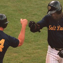 Salt Lake Buzz player Brian Buchanan (left) greets David Ortiz  after Ortiz hit the second Buzz homerun of the inning during the Thursday night game against Tucson at Franklin Covey Field on July 8, 1999.