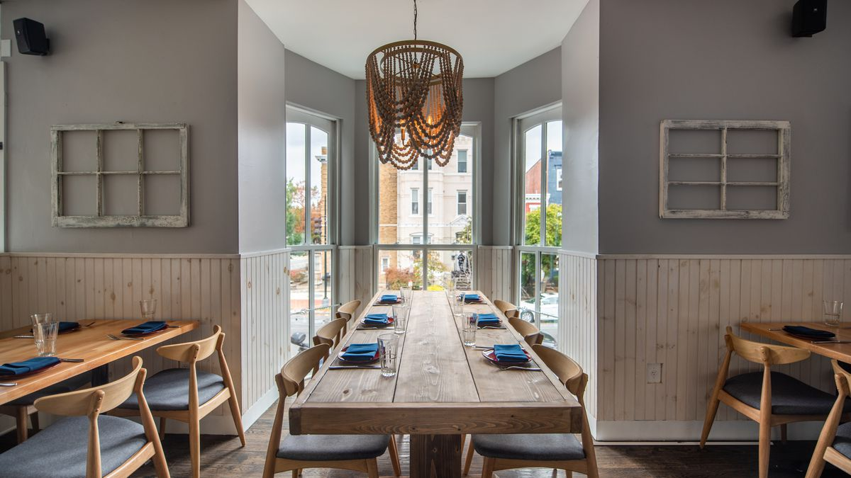 A communal table on the second floor of Nina May