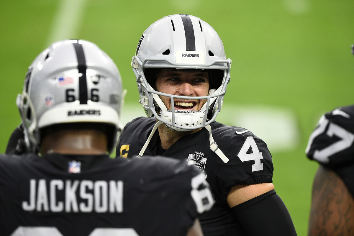 Quarterback Derek Carr #4 of the Las Vegas Raiders speaks to teammates on the sideline in the first half of their game against the Indianapolis Colts at Allegiant Stadium on December 13, 2020 in Las Vegas, Nevada.