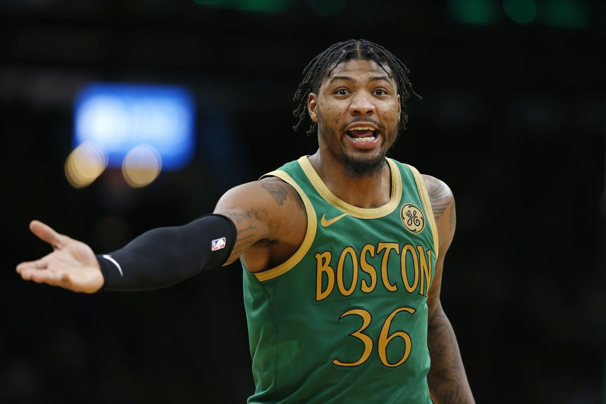 Boston Celtics guard Marcus Smart argues a call against his team during the first quarter against the Denver Nuggets at TD Garden.
