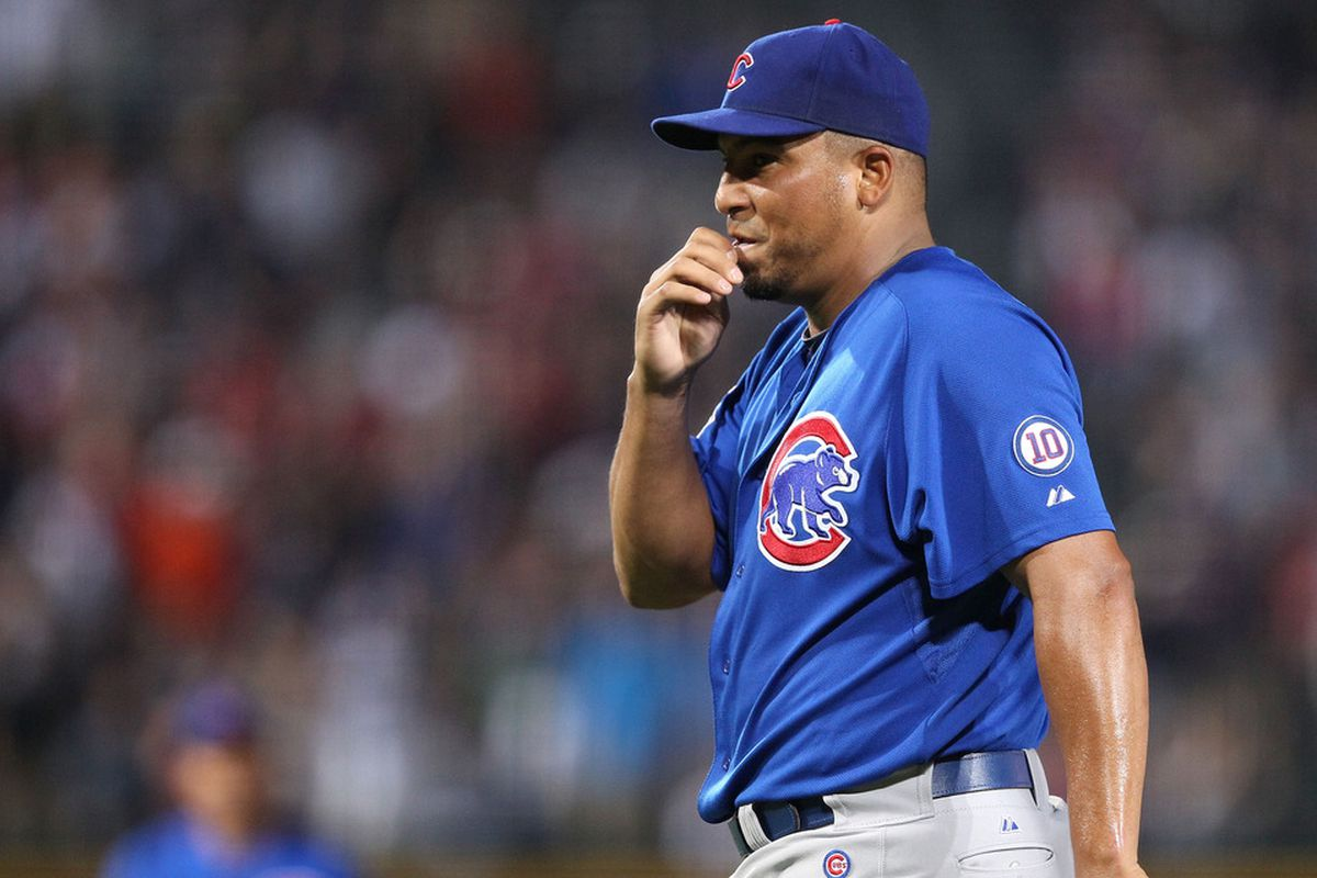 Pitcher Carlos Zambrano of the Chicago Cubs reacts after throwing a pitch that got him ejected from the game against the Atlanta Braves at Turner Field on August 12, 2011 in Atlanta, Georgia.  (Photo by Mike Zarrilli/Getty Images)