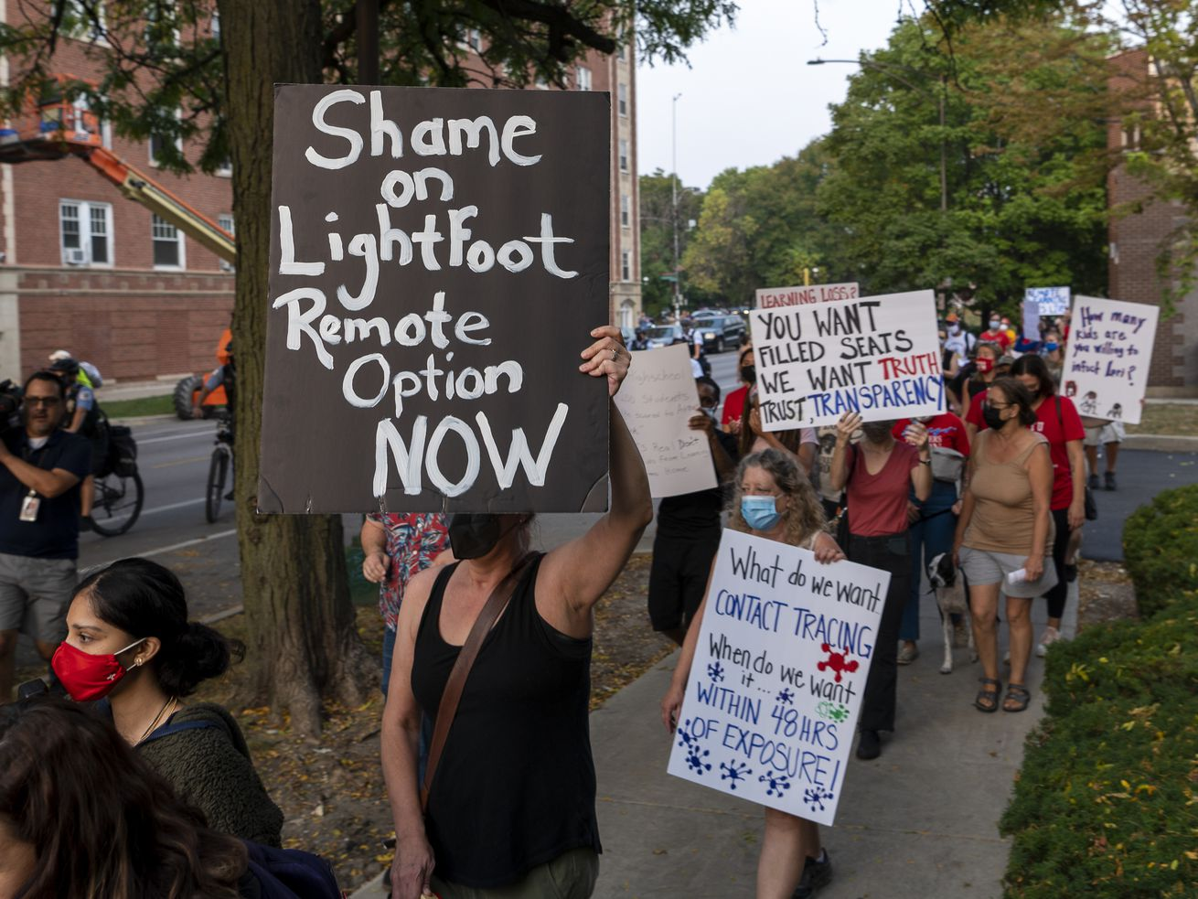 Around 40 parents, teachers and students march on Monday toward Mayor Lori Lightfoot's home in Logan Square Park, demanding that Chicago Public Schools have remote learning options. The protesters were blocked by police before they reached Lightfoot's home.