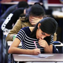 Student Alessandra Huamani takes a test in Syd Lott's IB Economics class at Skyline High School in Salt Lake City, Tuesday, Oct. 20, 2015.