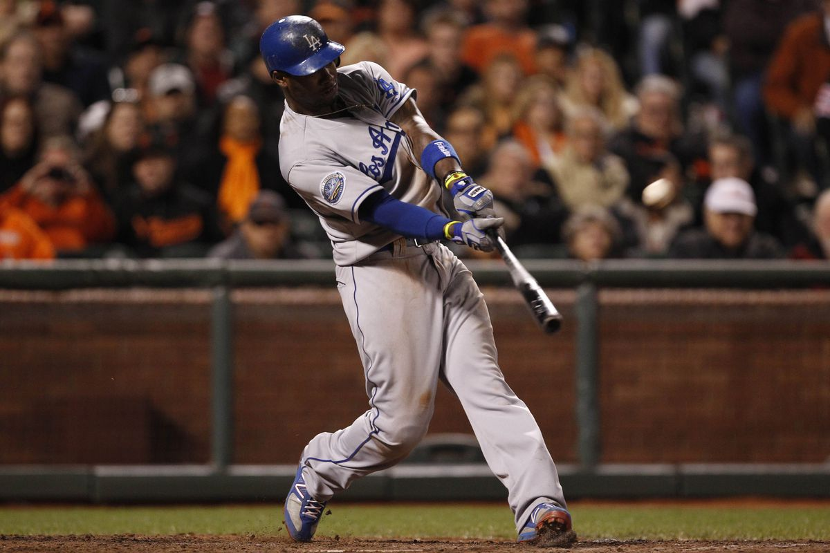 July 27, 2012; San Francisco, CA, USA; Los Angeles Dodgers third baseman Hanley Ramirez hits a two-run home run during the tenth inning against the San Francisco Giants at AT&T Park. Mandatory Credit: Beck Diefenbach-US PRESSWIRE