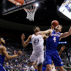 Brigham Young Cougars forward Yoeli Childs (23) and Texas Arlington Mavericks guard Drew Charles (4) try to get the rebound as BYU and the University of Texas at Arlington play in NIT basketball action at the Marriott Center in Provo, Utah on Wednesday, March 15, 2017.