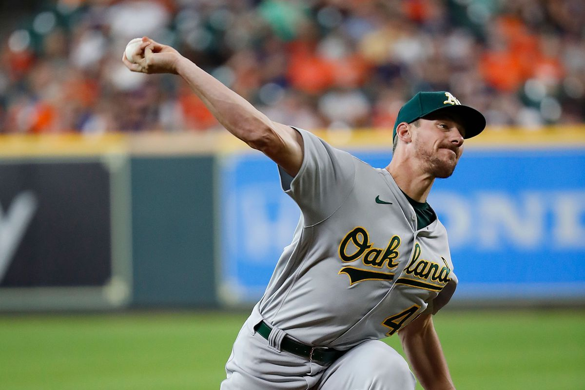 Chris Bassitt #40 of the Oakland Athletics pitches in the first inning against the Houston Astros at Minute Maid Park on July 06, 2021 in Houston, Texas.