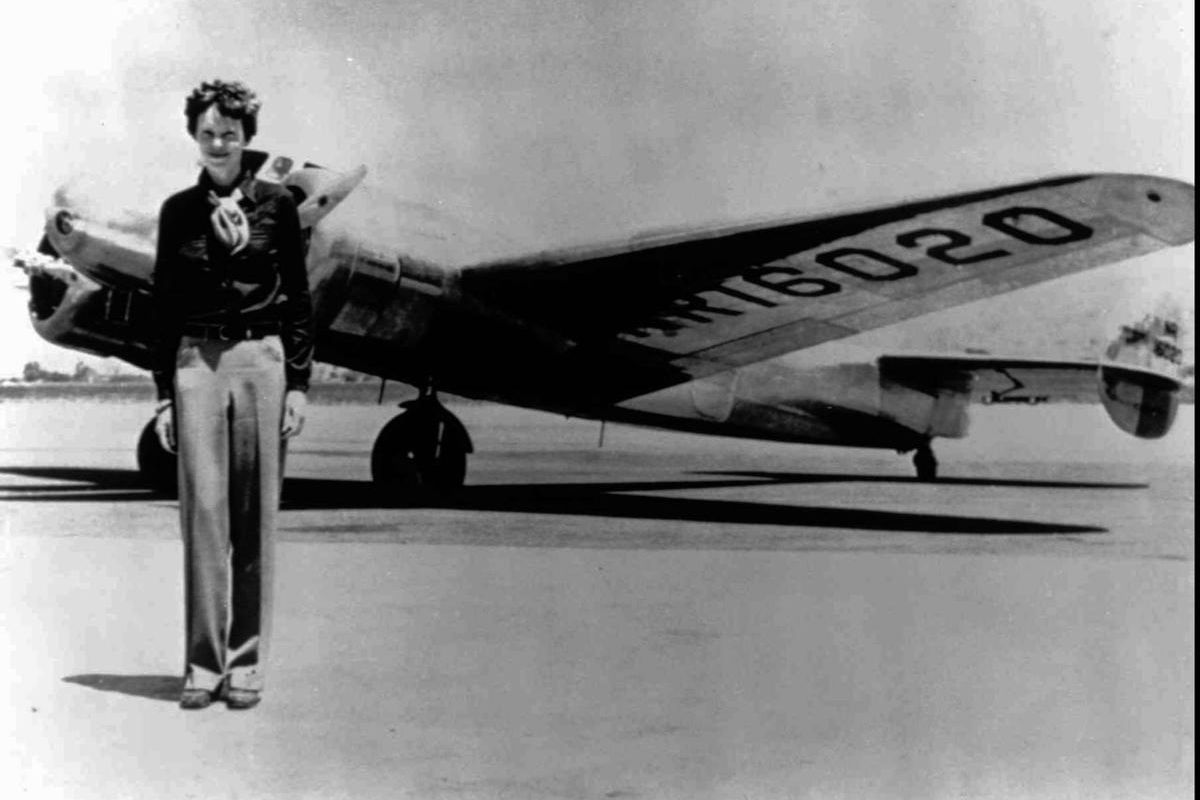 Amelia Earhart, 40, stands next to a Lockheed Electra 10E, before her last flight in 1937 from Oakland, Calif., bound for Honolulu on the first leg of her record-setting attempt to circumnavigate the world westward along the Equator. Her flight is being e