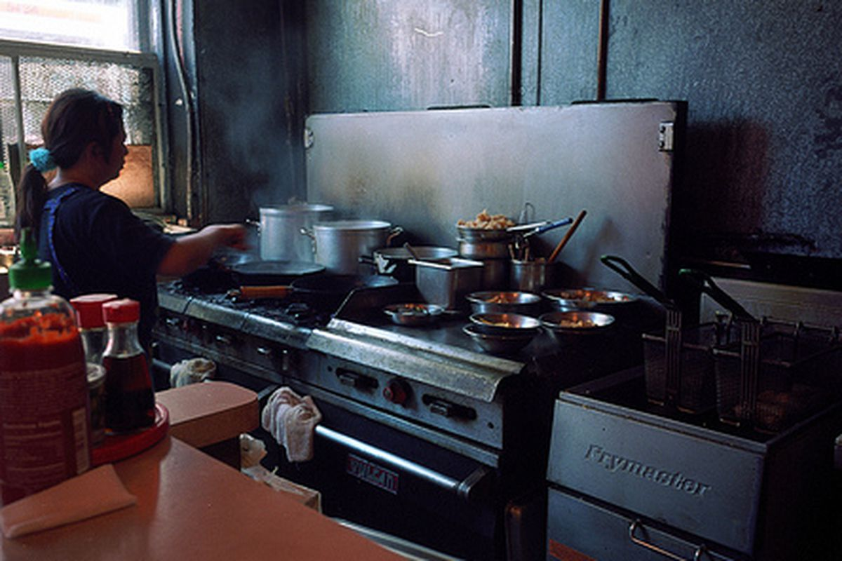 A chef cooking away at Yamo in the Mission.
