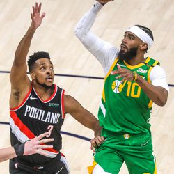 Utah Jazz guard Mike Conley (10) shoots over Portland Trail Blazer guard CJ McCollum (3) during the game at Vivint Smart Home Arena in Salt Lake City on Thursday, April 8, 2021.