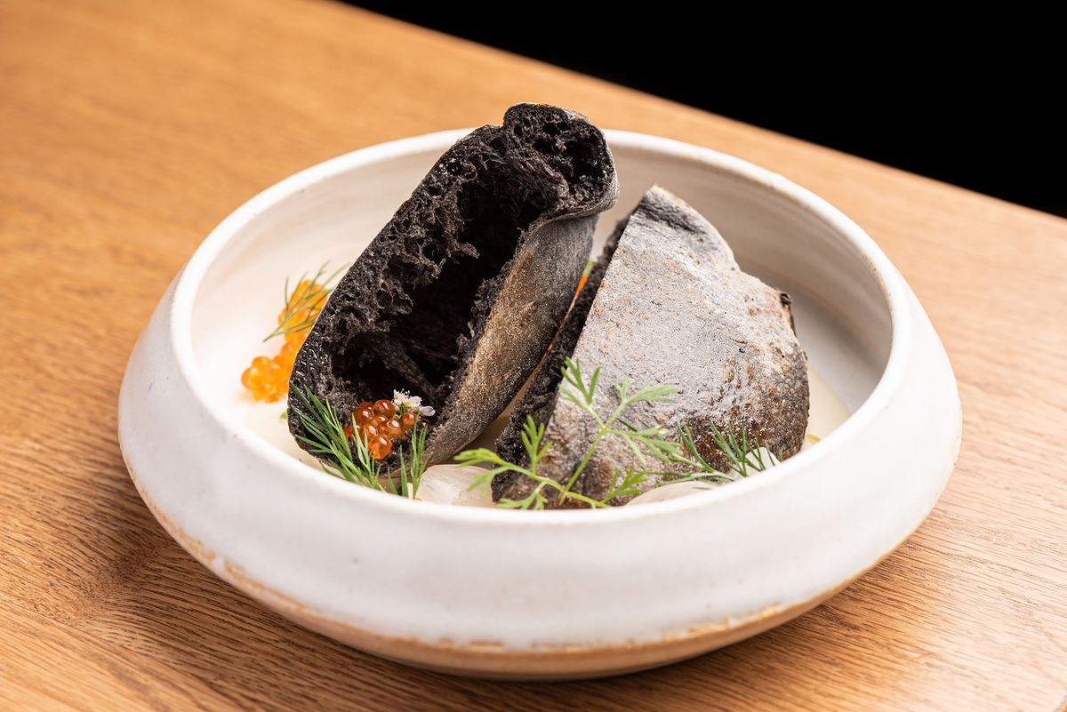 An open pita pocket dish, made black from squid ink.