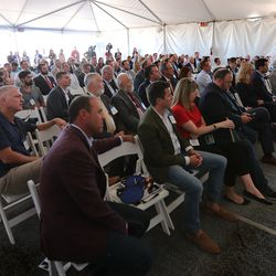 Guests listen to the speakers during a groundbreaking ceremony for Northrop Grumman's missile defense development facility in Roy on Tuesday, Aug. 27, 2019.