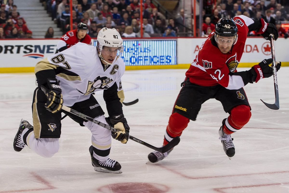 Mar 24, 2012; Ottawa, ON, CAN; Pittsburgh Penguins centre Sidney Crosby (87) and Ottawa Senators centre Jim O'Brien (42) chase the puck in the first period at Scotiabank Place. Mandatory Credit: Marc DesRosiers-US PRESSWIRE