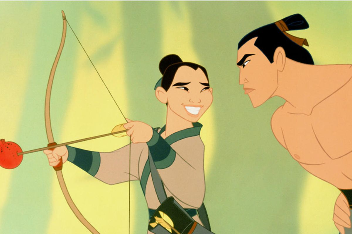 """Shang (voiced by B.D. Wong), right, shows Mulan (voiced by Ming-Na Wen) how to shoot an arrow in Disney's """"Mulan."""""""