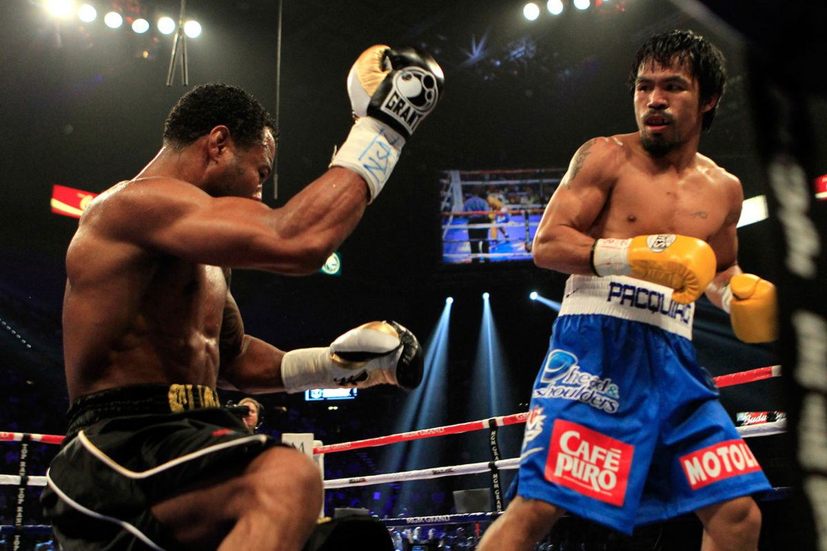 Manny Pacquiao is still flying high in the ring, but someday he may be in the Shane Mosley position. (Photo by Chris Trotman/Getty Images)