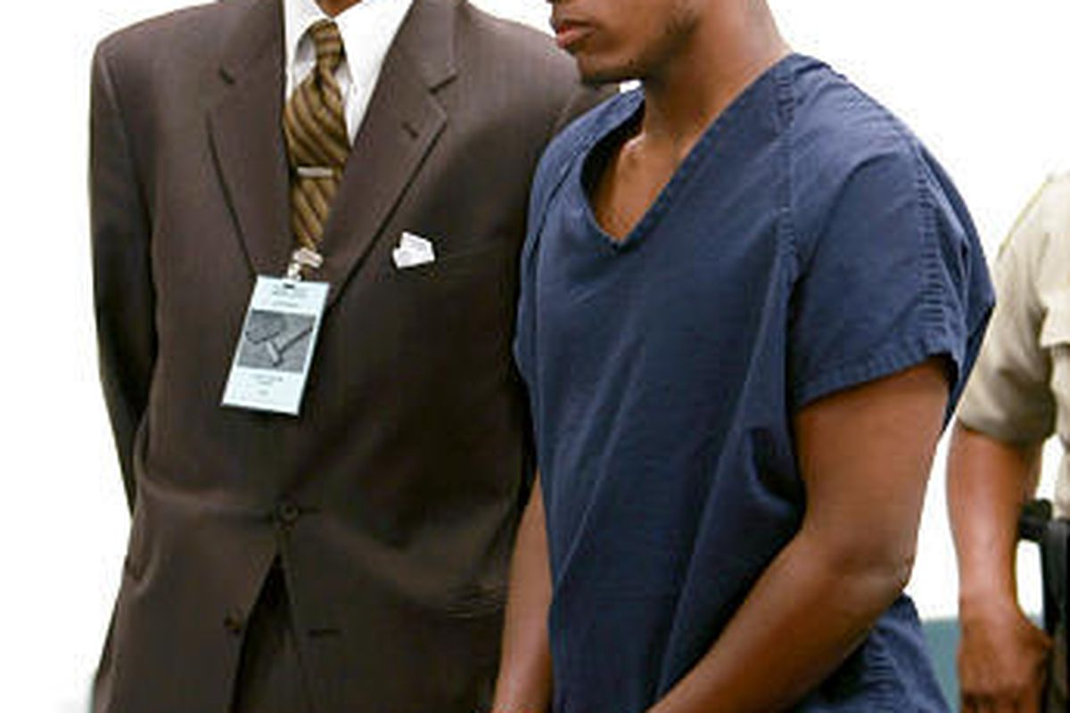 Demario Ware, 20, right, makes his first appearance in court Wednesday at the Fulton County jail in Atlanta, Ga. Ware is charged with murder, aggravated assault and armed robbery in the shooting death of boxer Vernon Forrest. Ware's attorney, Curtis Hubba