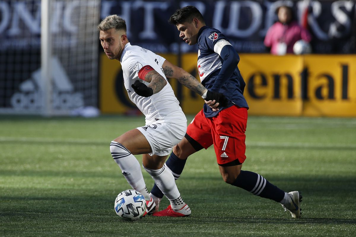 Chicago Fire defender Francisco Calvo and New England Revolution forward Gustavo Bou battle for the ball during the second half at Gillette Stadium.