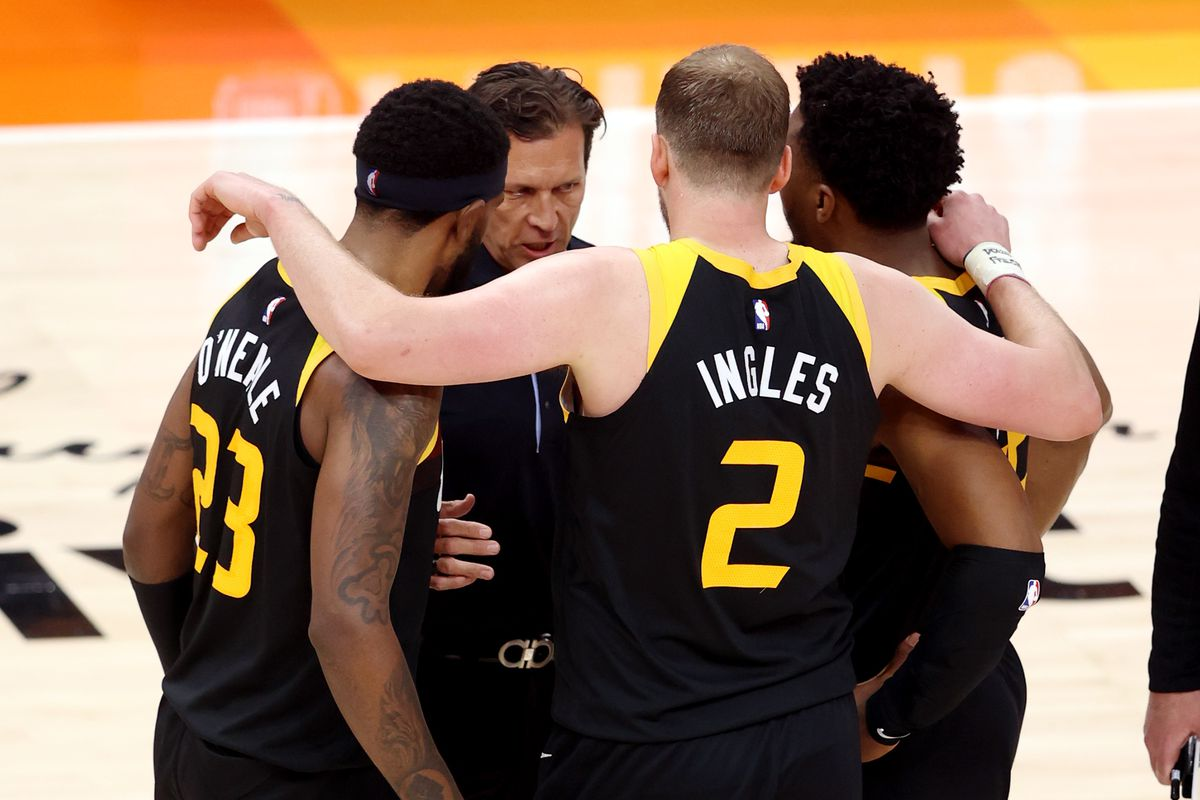 Utah Jazz coach Quin Snyder talks with Royce O'Neale, Joe Ingles and Donovan Mitchell at Vivint Arena in Salt Lake City.