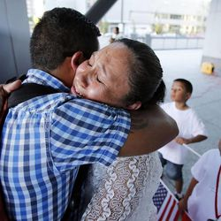 Ana Canenguez is hugged by Israel Valerdi after relating how members of her family will be deported. This is during a prayer vigil in Salt Lake City, Thursday, June 27, 2013 for immigration reform.