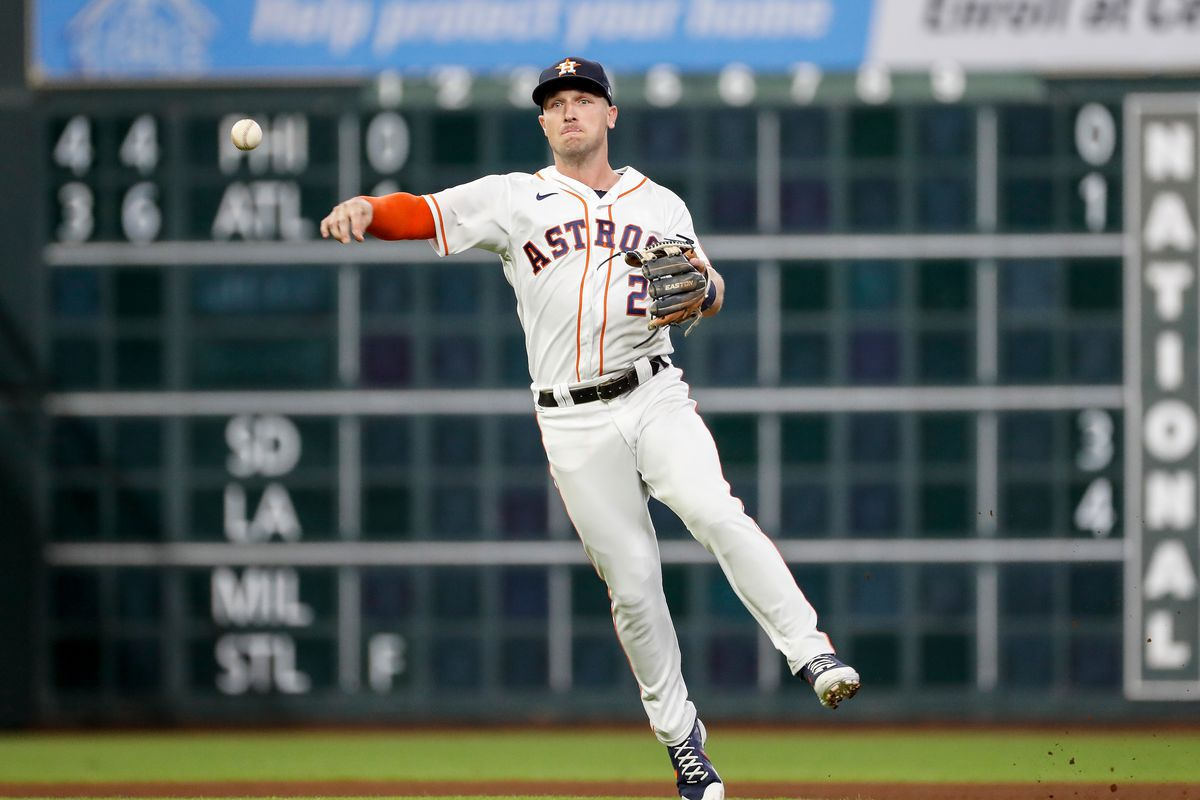 Alex Bregman #2 of the Houston Astros throws to first for an out in the third inning against the Tampa Bay Rays at Minute Maid Park on September 30, 2021 in Houston, Texas.