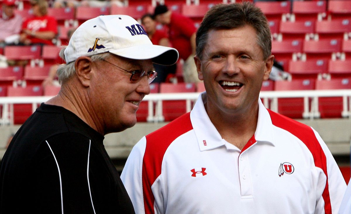 University of Utah head coach Kyle Whittingham has a laugh with former University of Utah coach and current Weber State University coach Ron McBride as the University of Utah host Weber State at Rice Eccles Stadium in Salt Lake City, Utah. September 27, 2008.