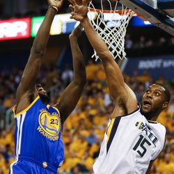 Golden State Warriors forward Draymond Green #23 attempts a rebound with Utah Jazz forward Derrick Favors #15 during game four of the Western Conference Semifinal at Vivant Smart Home Arena in Salt Lake City on Monday, May 8, 2017.