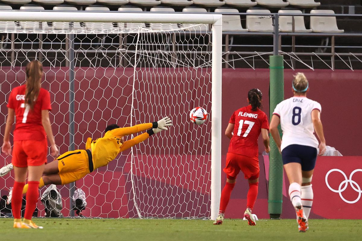 Adrianna Franch of Team United States fails to save a penalty from Jessie Fleming of Team Canada as she goes on to score her side's first goal during the Women's Semi-Final match between USA and Canada on day ten of the Tokyo Olympic Games at Kashima Stadium on August 02, 2021 in Kashima, Ibaraki, Japan.