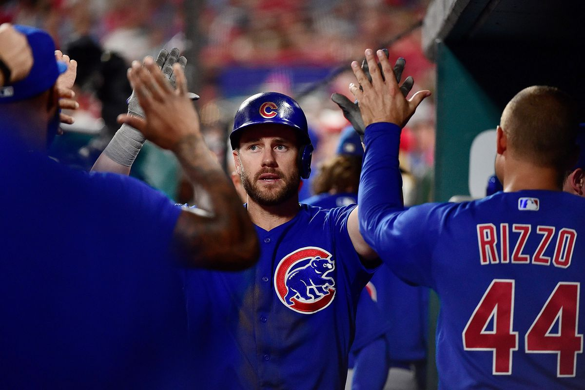 St. Louis, Missouri, USA; Chicago Cubs third baseman Patrick Wisdom (16) is congratulated by teammates after hitting a solo home run off of St. Louis Cardinals relief pitcher Andrew Miller (not pictured) during the seventh inning at Busch Stadium.