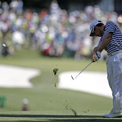 Louis Oosthuizen, of South Africa, hits off the first fairway during the third round of the Masters golf tournament Saturday, April 7, 2012, in Augusta, Ga.