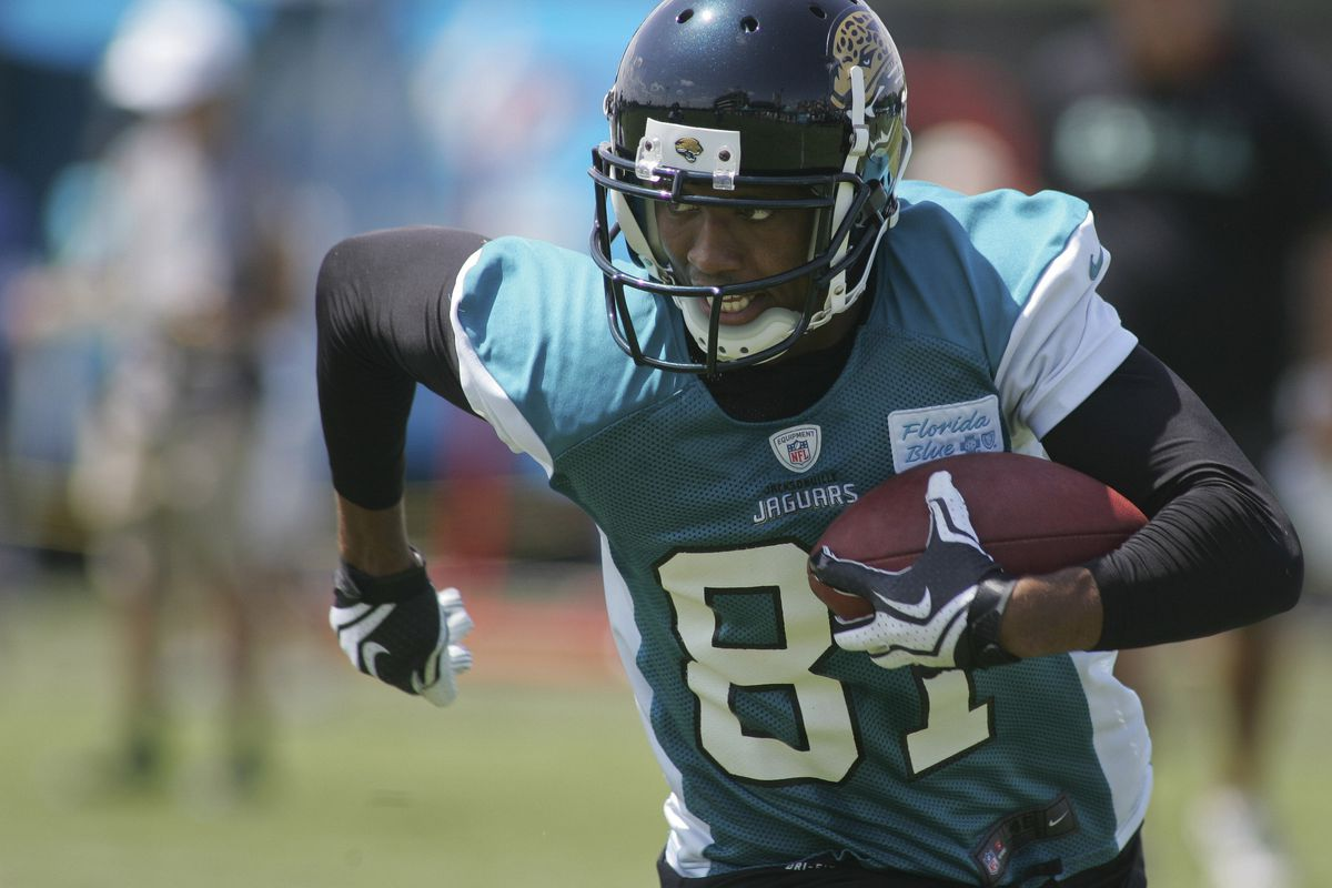 July 27, 2012; Jacksonville FL, USA; Jacksonville Jaguars wide receiver Laurent Robinson (81) runs during the first afternoon of training camp practice at Florida Blue Health & Wellness Practice Fields. Mandatory Credit: Phil Sears-US PRESSWIRE