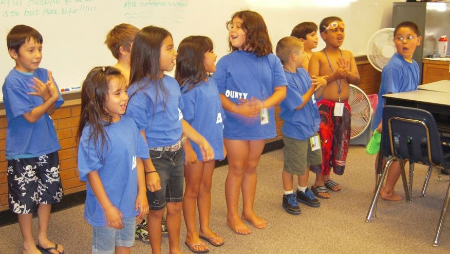 First-graders at Adams County Camp sing a song while they prepare to go swimming.
