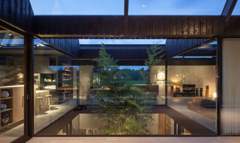 Solar-powered modern house is an airy retreat melded into the ...