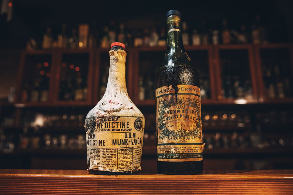 two old bottles of benedictine and vermouth