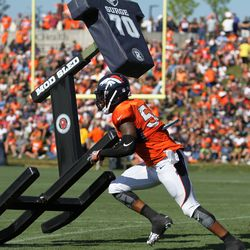 Broncos ILB Todd Davis looks beyond the sled he's thrown before it hits the ground.