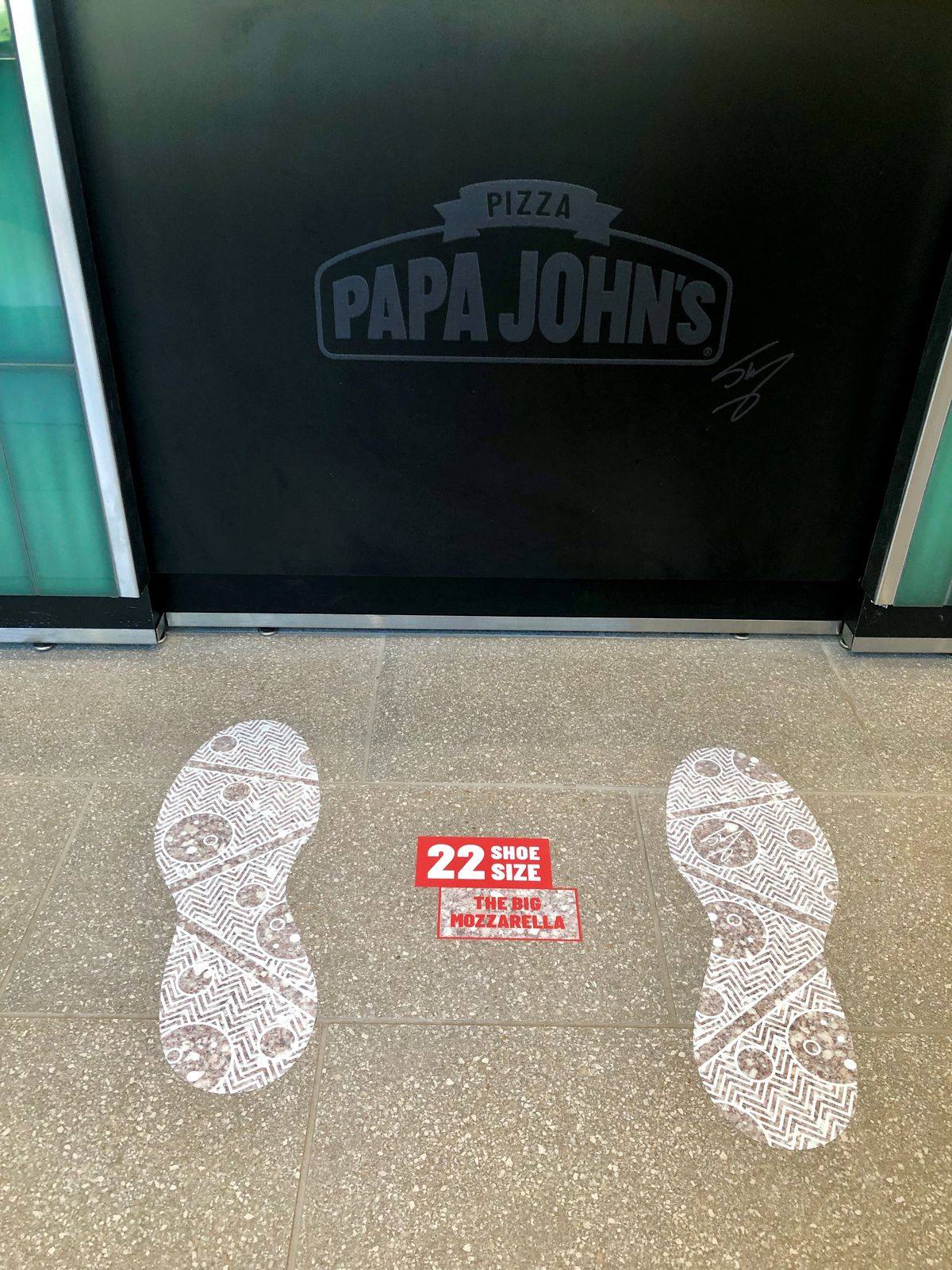 Shaq's size 22 shoe prints at the entrance to his new State Street Papa John's