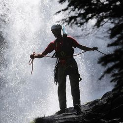 A member of the Salt Lake County Search and Rescue team stretches a length of rope while gearing up to help recover the body of a 22-year-old hiker who fell in Bell Canyon on Monday, June 5, 2017. Siaosi Brown's body was spotted in the lower falls of the canyon. His body was trapped on some logs in the middle of the waterfall, Unified Police Lt. Brian Lohrke said.