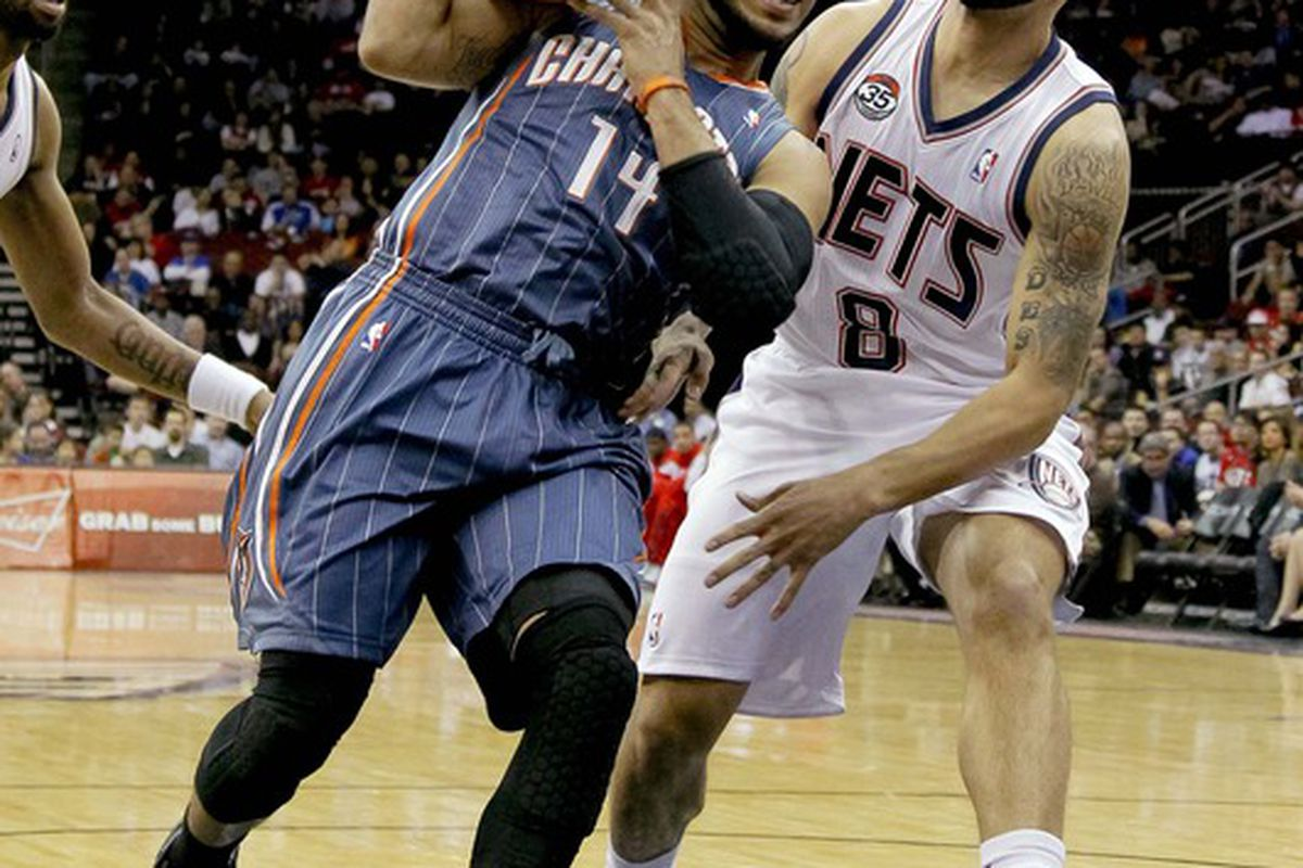 Mar 24, 2012; Newark, NJ, USA;  Charlotte Bobcats point guard D.J. Augustin (14) drives to the basket against New Jersey Nets point guard Deron Williams (8) during the first half at the Prudential Center. Mandatory Credit: Jim O'Connor-US PRESSWIRE