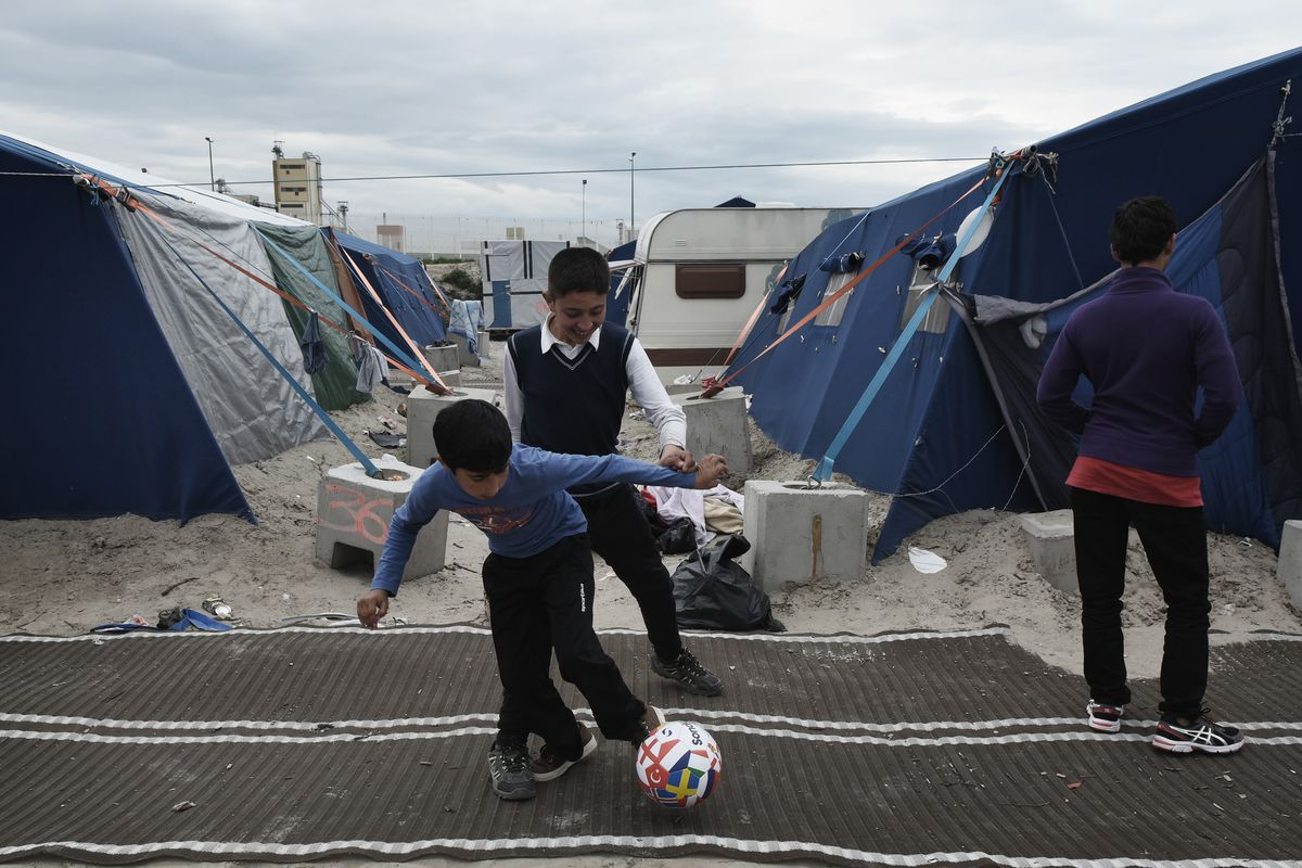 """An Afghani child in a French refugee camp known as """"The Jungle""""."""