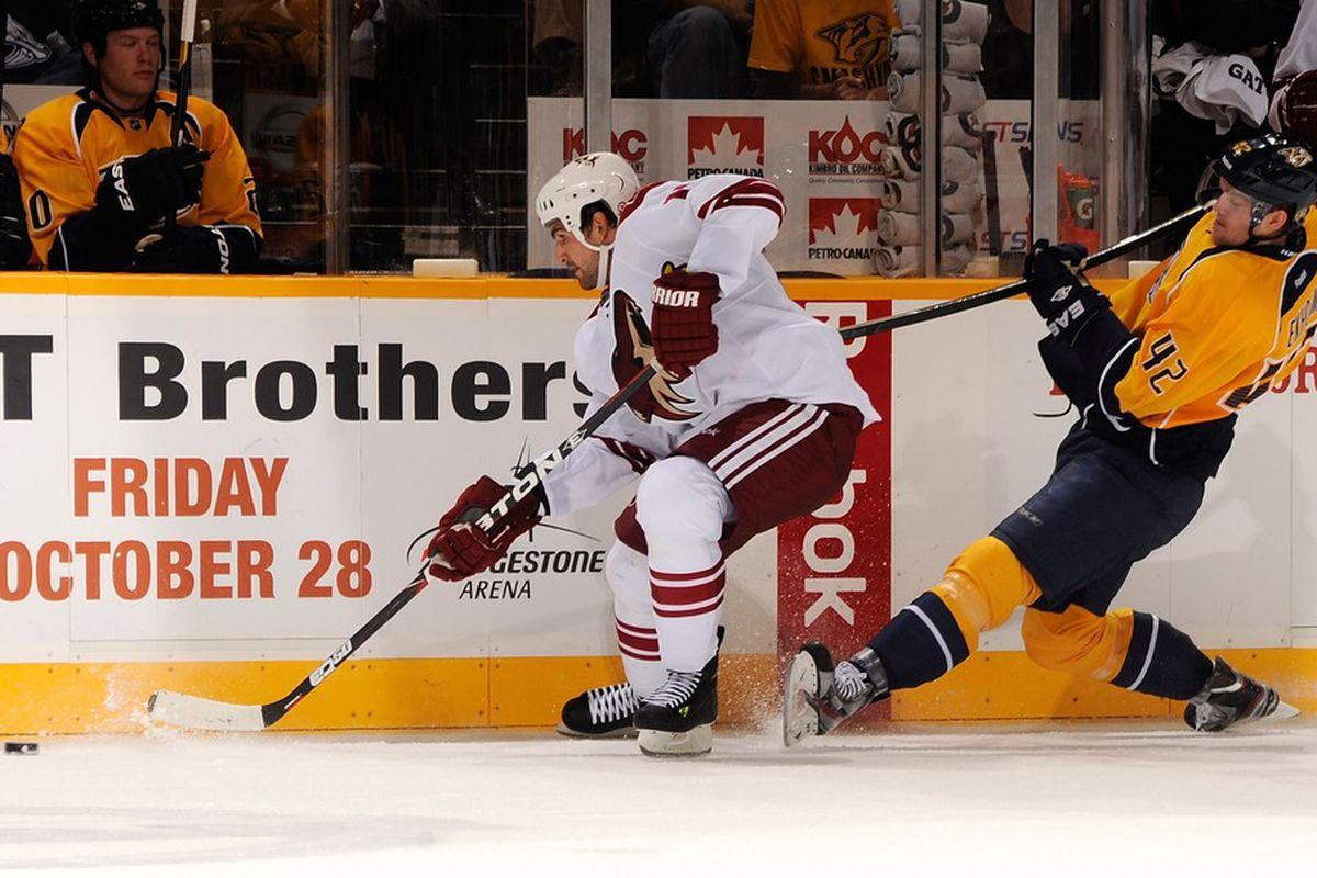 NASHVILLE, TN - OCTOBER 13:  Martin Hanzal #11 of the Phoenix Coyotes gets hooked by Mattias Ekholm #42 of the Nashville Predators at the Bridgestone Arena on October 13, 2011 in Nashville, Tennessee.  (Photo by Frederick Breedon/Getty Images)