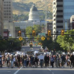 Protesters decrying the police shooting of Bernardo Palacios-Carbajal march on State Street in Salt Lake City on Thursday, July 9, 2020.