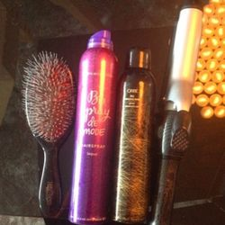 """My """"mane"""" MVPs for third-day hair (I wash my hair twice a week—don't judge!): A <strong>T3 curling iron</strong> to smooth out my texture, <strong>Bumble and bumble Spray De Mode Hairspray</strong> (buildable but lightweight), <strong>Oribe Dry Texturing"""