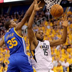 Utah Jazz forward Derrick Favors (15) drops the ball as he shoots in front of Golden State Warriors forward Kevin Durant (35) during game 4 of the second round of NBA playoffs at the Vivint Smart Home Arena in Salt Lake City on Monday, May 8, 2017. The Jazz lost 95-121.