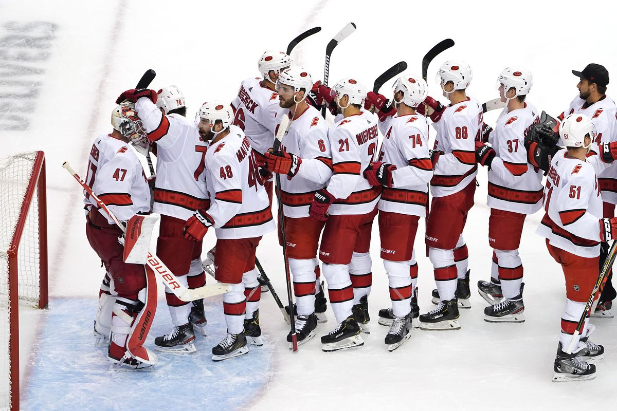 James Reimer of the Carolina Hurricanes celebrates with his teammates after defeating the New York Rangers in Game Three of the Eastern Conference Qualification Round prior to the 2020 NHL Stanley Cup Playoffs at Scotiabank Arena on August 04, 2020 in Toronto, Ontario, Canada.